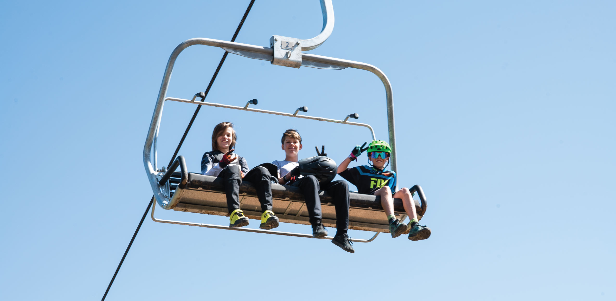 Riding the Hot Laps Quad chairlift.