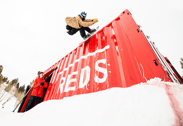 red gerard snowboarding in reds backyard